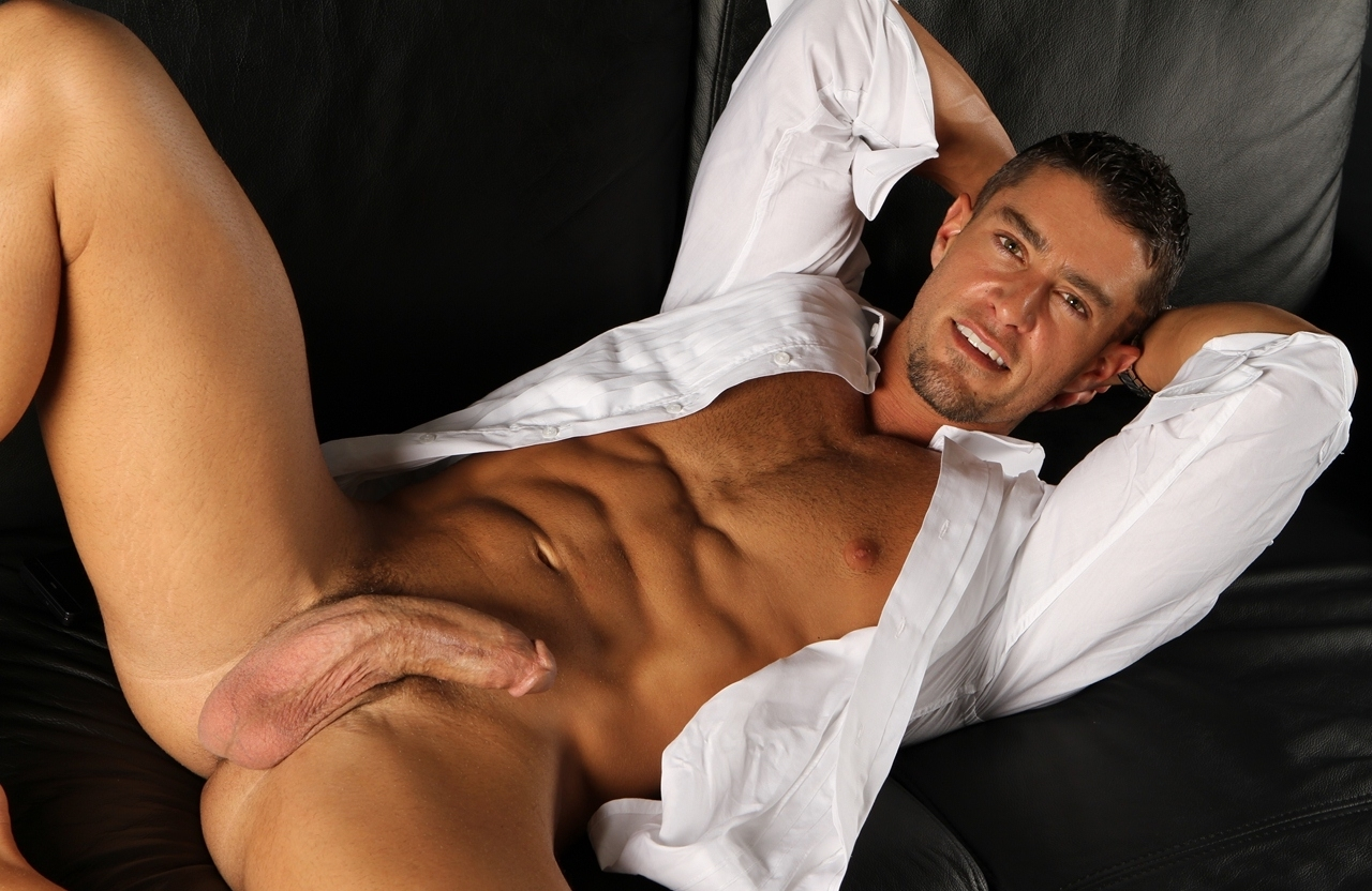 Gay model in white shirt showing his penis